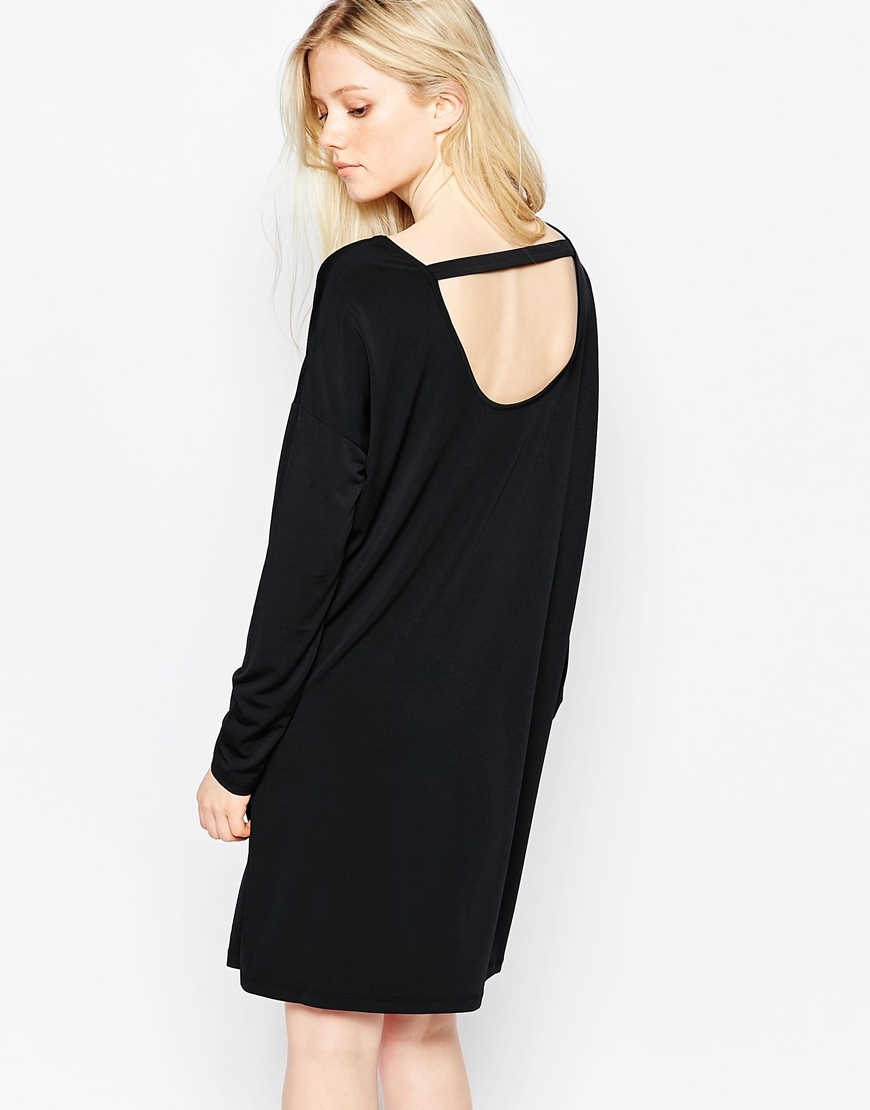 Tunic Dress Black - style: tunic; length: mid thigh; sleeve style: dolman/batwing; pattern: plain; back detail: low cut/open back; predominant colour: black; occasions: evening; fit: body skimming; neckline: scoop; fibres: polyester/polyamide - stretch; sleeve length: long sleeve; pattern type: fabric; texture group: other - light to midweight; season: a/w 2015; wardrobe: event