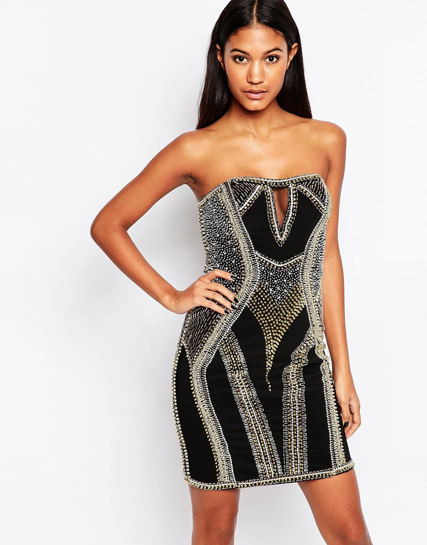 Leesa Heavily Embellished Mini Dress Black - style: shift; length: mid thigh; neckline: strapless (straight/sweetheart); fit: tight; sleeve style: strapless; hip detail: draws attention to hips; secondary colour: silver; predominant colour: black; occasions: evening; fibres: polyester/polyamide - 100%; sleeve length: sleeveless; pattern type: fabric; pattern size: standard; pattern: patterned/print; texture group: woven light midweight; season: a/w 2015; wardrobe: event; embellishment location: bust, waist