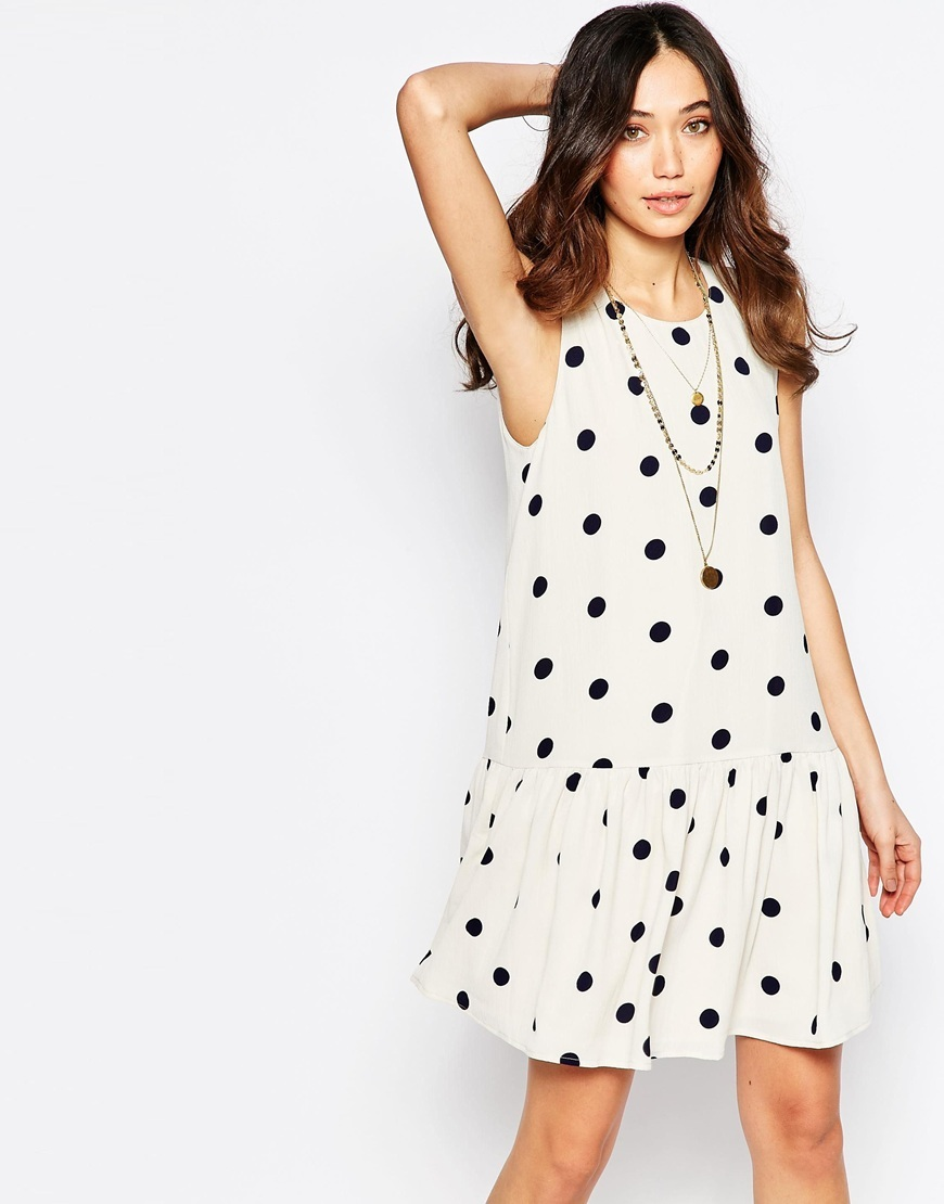 Polka Dot Drop Waist Dress Moonbeam - neckline: round neck; sleeve style: sleeveless; style: drop waist; waist detail: drop waist; pattern: polka dot; predominant colour: ivory/cream; secondary colour: black; occasions: casual; length: just above the knee; fit: soft a-line; fibres: polyester/polyamide - 100%; hip detail: subtle/flattering hip detail; sleeve length: sleeveless; pattern type: fabric; texture group: other - light to midweight; season: a/w 2015; wardrobe: highlight