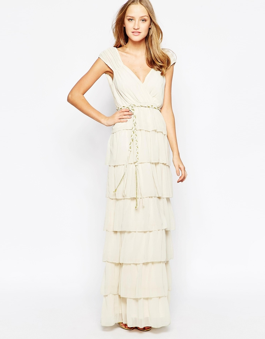 Candy Chiffon Blessings Ra Ra Maxi Dress Cream - neckline: v-neck; sleeve style: capped; pattern: plain; style: maxi dress; waist detail: belted waist/tie at waist/drawstring; predominant colour: ivory/cream; occasions: evening; length: floor length; fit: body skimming; fibres: polyester/polyamide - 100%; hip detail: adds bulk at the hips; sleeve length: short sleeve; texture group: sheer fabrics/chiffon/organza etc.; pattern type: fabric; season: a/w 2015; wardrobe: event
