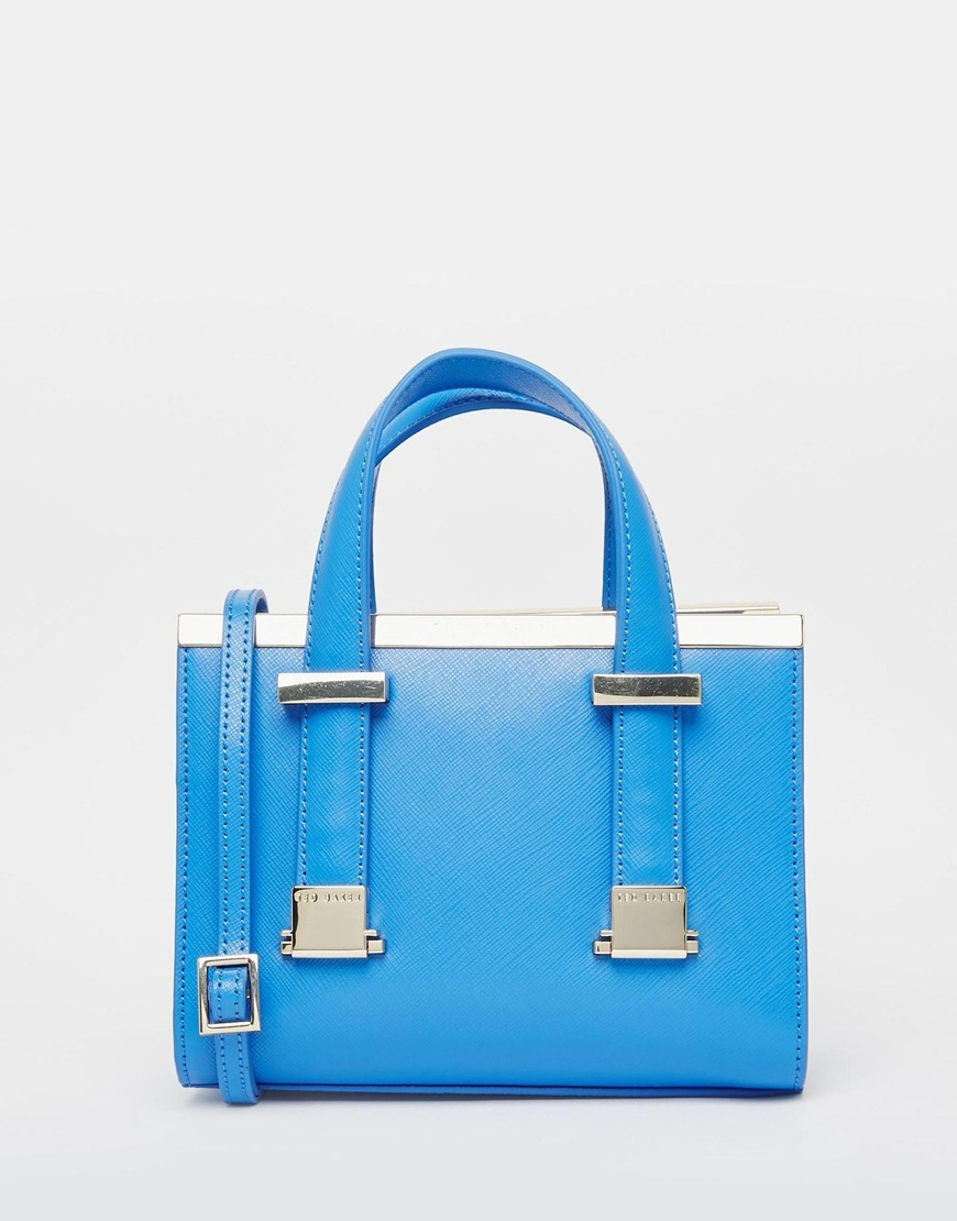 Leather Metal Bar Minature Tote Light Blue - predominant colour: diva blue; secondary colour: gold; occasions: casual, creative work; type of pattern: standard; style: tote; length: handle; size: small; material: leather; pattern: plain; finish: plain; embellishment: chain/metal; season: a/w 2015