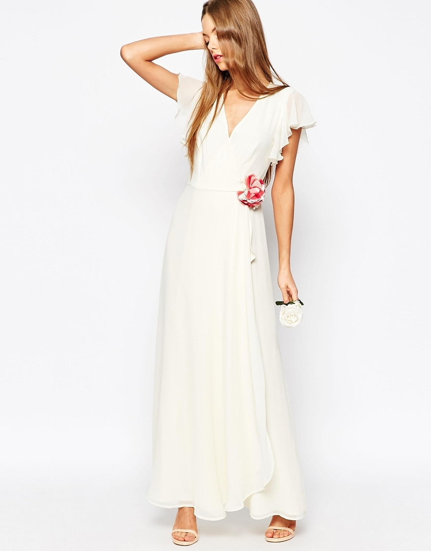 Wedding Corsage Wrap Maxi Dress White - style: faux wrap/wrap; neckline: v-neck; sleeve style: capped; pattern: plain; length: ankle length; predominant colour: white; fit: soft a-line; fibres: polyester/polyamide - 100%; occasions: occasion; sleeve length: short sleeve; texture group: sheer fabrics/chiffon/organza etc.; pattern type: fabric; embellishment: corsage; season: a/w 2015; wardrobe: event; embellishment location: waist