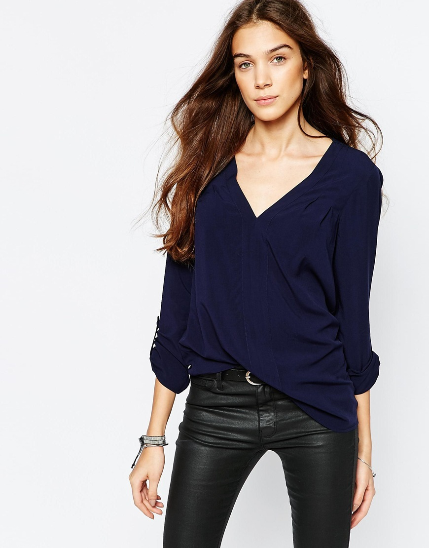 Plunge Neck Blouse Navy - neckline: low v-neck; pattern: plain; style: blouse; predominant colour: navy; occasions: casual, work, creative work; length: standard; fibres: viscose/rayon - 100%; fit: body skimming; sleeve length: long sleeve; sleeve style: standard; pattern type: fabric; texture group: other - light to midweight; season: a/w 2015; wardrobe: basic