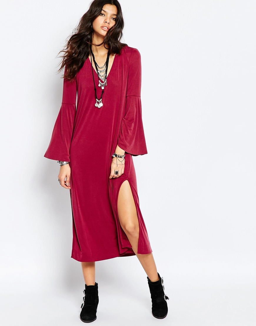 Cupro Romance Midi Dress In Scarlet Scarlet - style: shift; length: calf length; neckline: low v-neck; sleeve style: dolman/batwing; pattern: plain; hip detail: draws attention to hips; occasions: casual; fit: straight cut; fibres: cotton - stretch; sleeve length: long sleeve; pattern type: fabric; texture group: jersey - stretchy/drapey; predominant colour: raspberry; season: a/w 2015; wardrobe: highlight