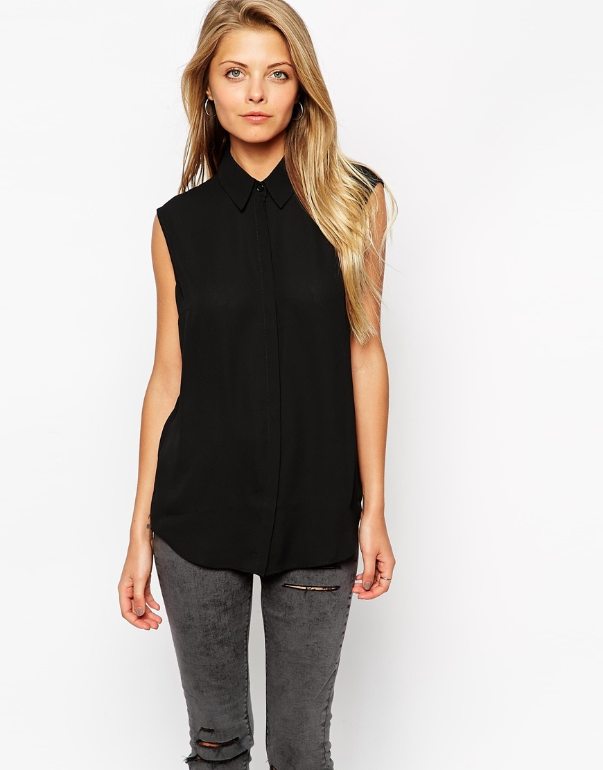 Sleeveless Blouse Black - neckline: v-neck; pattern: plain; sleeve style: sleeveless; length: below the bottom; style: blouse; predominant colour: black; occasions: casual, creative work; fibres: polyester/polyamide - 100%; fit: body skimming; sleeve length: sleeveless; pattern type: fabric; texture group: other - light to midweight; season: a/w 2015