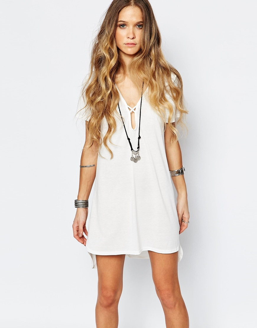 Plunge Neck Dress With Cross Strapping Cream - style: shift; length: mid thigh; neckline: v-neck; pattern: plain; predominant colour: ivory/cream; occasions: casual, creative work; fit: soft a-line; fibres: polyester/polyamide - stretch; sleeve length: short sleeve; sleeve style: standard; texture group: jersey - clingy; pattern type: fabric; season: a/w 2015; wardrobe: basic