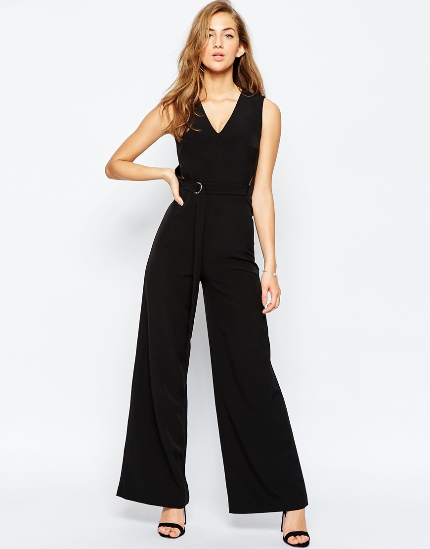 Premium Belted Jumpsuit With Cut Out Black - neckline: low v-neck; pattern: plain; sleeve style: sleeveless; predominant colour: black; occasions: evening, occasion; length: ankle length; fit: fitted at waist & bust; fibres: polyester/polyamide - stretch; sleeve length: sleeveless; style: jumpsuit; pattern type: fabric; texture group: jersey - stretchy/drapey; season: a/w 2015