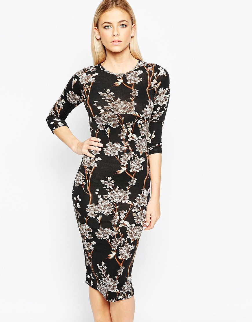 Midi Dress In Blossom Print Black - style: shift; length: below the knee; neckline: round neck; hip detail: draws attention to hips; secondary colour: white; predominant colour: black; occasions: evening, occasion; fit: body skimming; fibres: viscose/rayon - stretch; sleeve length: 3/4 length; sleeve style: standard; texture group: crepes; pattern type: fabric; pattern size: standard; pattern: florals; season: a/w 2015; wardrobe: event