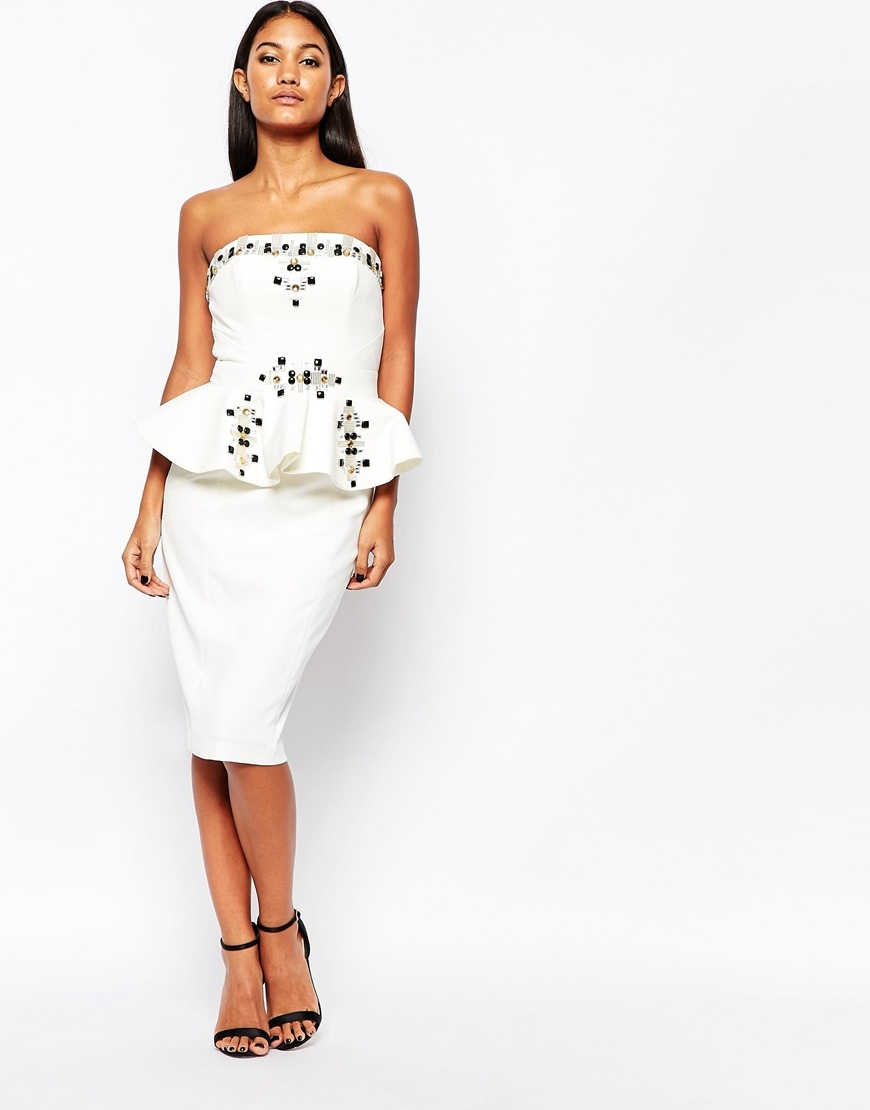 Stacey Peplum Midi Dress With Embellishment Ivory - style: shift; length: below the knee; neckline: strapless (straight/sweetheart); fit: tailored/fitted; pattern: plain; sleeve style: sleeveless; waist detail: peplum waist detail; predominant colour: white; fibres: polyester/polyamide - 100%; occasions: occasion; sleeve length: sleeveless; pattern type: fabric; pattern size: standard; texture group: other - light to midweight; season: a/w 2015; wardrobe: event; embellishment location: bust