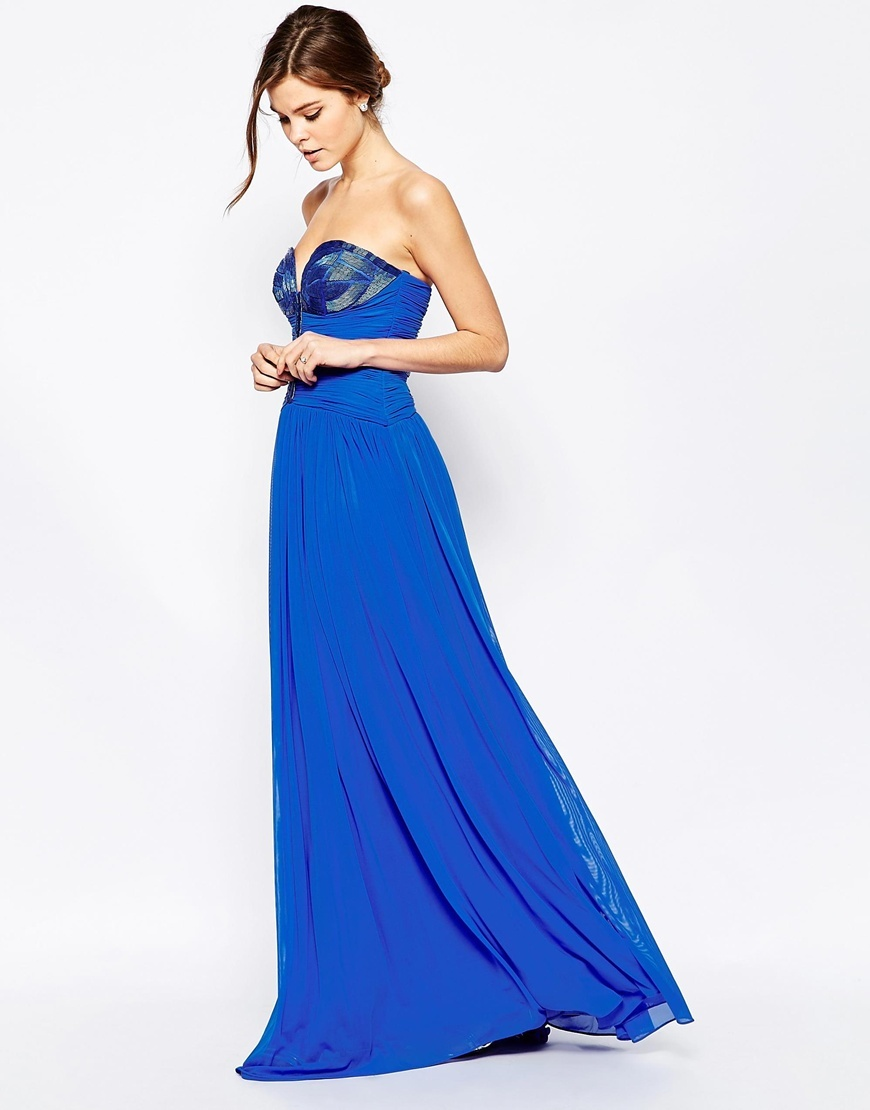 Cecilia Beaded Bandeau Maxi Dress Sax Blue - neckline: strapless (straight/sweetheart); pattern: plain; style: maxi dress; sleeve style: strapless; back detail: low cut/open back; waist detail: twist front waist detail/nipped in at waist on one side/soft pleats/draping/ruching/gathering waist detail; predominant colour: royal blue; secondary colour: navy; length: floor length; fit: fitted at waist & bust; occasions: occasion; hip detail: soft pleats at hip/draping at hip/flared at hip; bust detail: contrast pattern/fabric/detail at bust; sleeve length: sleeveless; texture group: sheer fabrics/chiffon/organza etc.; pattern type: fabric; embellishment: beading; fibres: nylon - stretch; season: a/w 2015