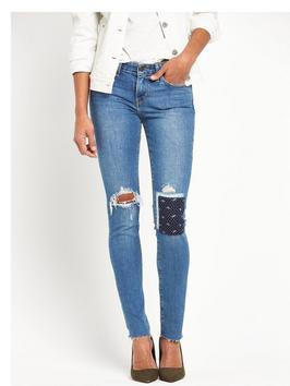 Levi 711 Rip And Patch Skinny Jeans - style: skinny leg; length: standard; pattern: plain; waist: high rise; pocket detail: traditional 5 pocket; predominant colour: denim; occasions: casual; fibres: cotton - stretch; texture group: denim; pattern type: fabric; jeans detail: rips; season: s/s 2016; wardrobe: basic