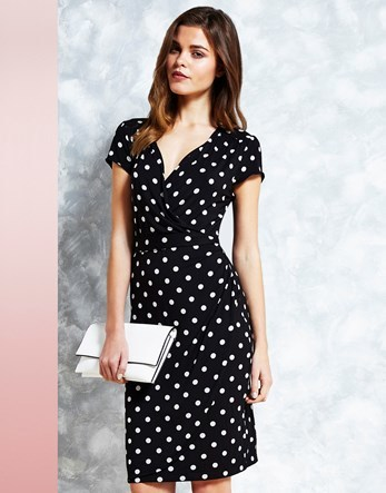 Polka Dot Jersey Wrap Dress - style: faux wrap/wrap; neckline: v-neck; sleeve style: capped; pattern: polka dot; secondary colour: white; predominant colour: black; occasions: evening; length: on the knee; fit: body skimming; fibres: polyester/polyamide - stretch; sleeve length: short sleeve; pattern type: fabric; texture group: jersey - stretchy/drapey; season: a/w 2015; wardrobe: event