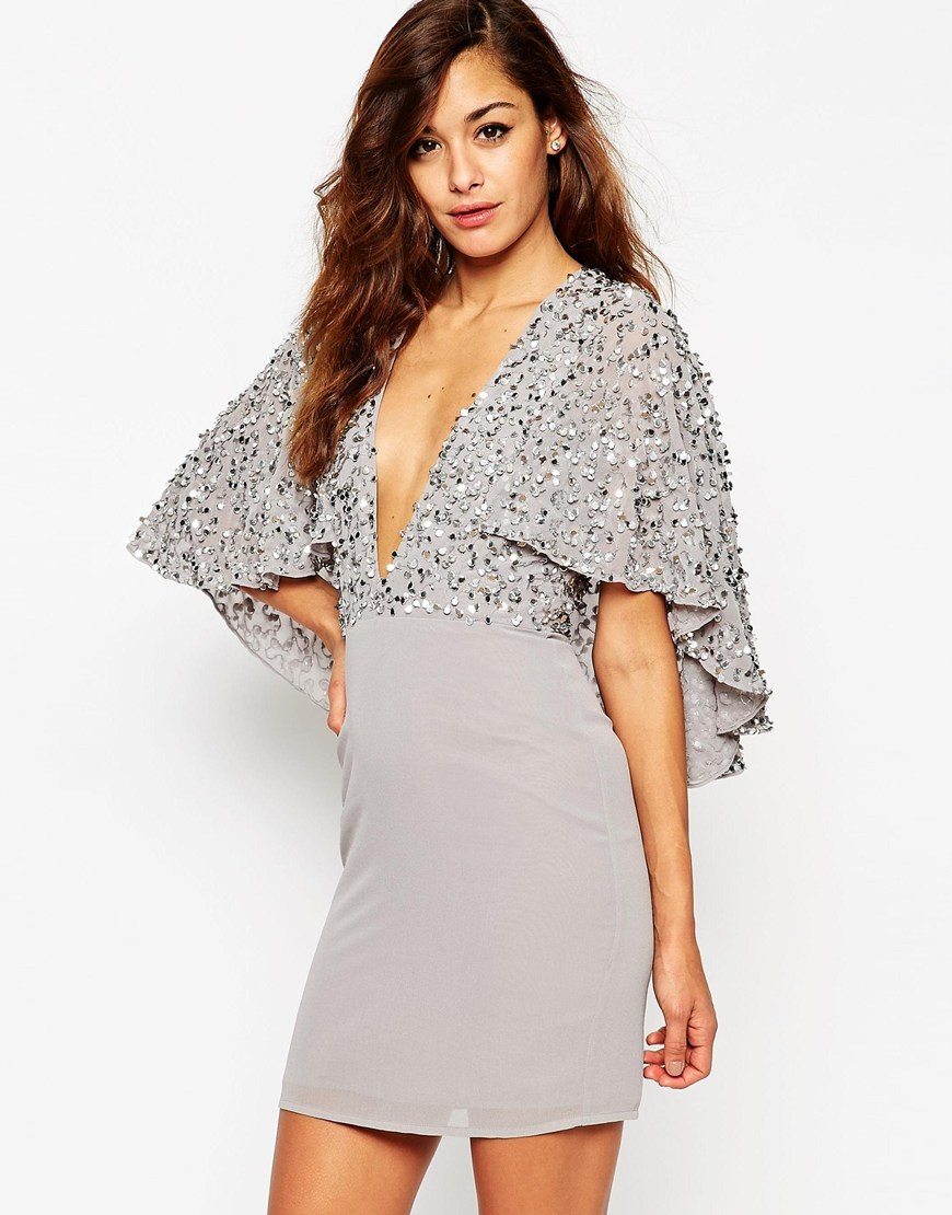Embellished Cape Back Mini Dress Grey - style: shift; length: mini; neckline: plunge; sleeve style: dolman/batwing; pattern: plain; predominant colour: light grey; occasions: evening; fit: body skimming; fibres: polyester/polyamide - 100%; sleeve length: 3/4 length; pattern type: fabric; texture group: other - light to midweight; embellishment: sequins; season: a/w 2015; wardrobe: event