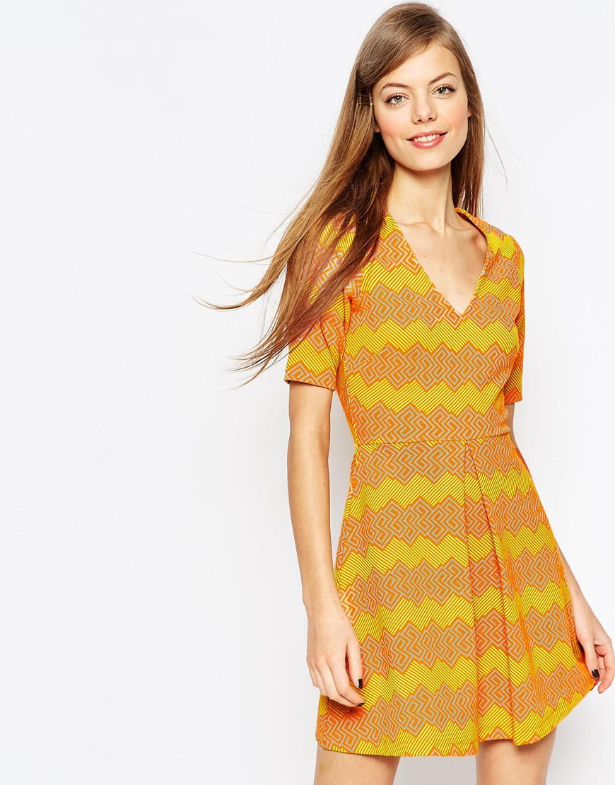 A Line Skater Dress In Bright Zig Zag Jacquard Orange - neckline: low v-neck; predominant colour: yellow; secondary colour: bright orange; occasions: casual; length: just above the knee; fit: fitted at waist & bust; style: fit & flare; fibres: cotton - mix; sleeve length: short sleeve; sleeve style: standard; pattern type: fabric; pattern: patterned/print; texture group: woven light midweight; season: a/w 2015; wardrobe: highlight