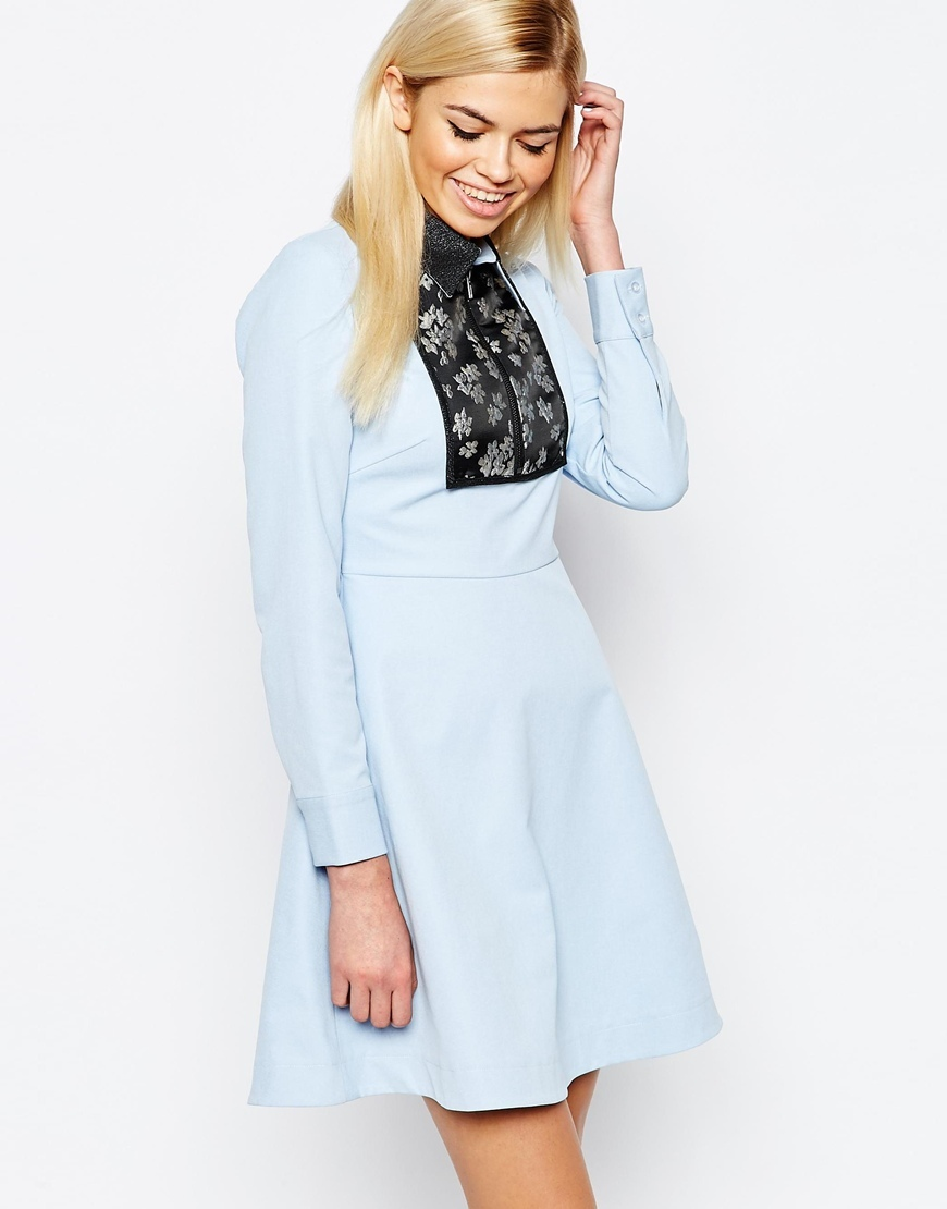 Electric Lily Dress With Jacquard Panel Blue - length: mid thigh; neckline: high neck; bust detail: added detail/embellishment at bust; predominant colour: pale blue; secondary colour: black; occasions: evening; fit: fitted at waist & bust; style: fit & flare; fibres: polyester/polyamide - 100%; sleeve length: long sleeve; sleeve style: standard; pattern type: fabric; pattern size: light/subtle; pattern: patterned/print; texture group: woven light midweight; embellishment: lace; multicoloured: multicoloured; season: a/w 2015; wardrobe: event