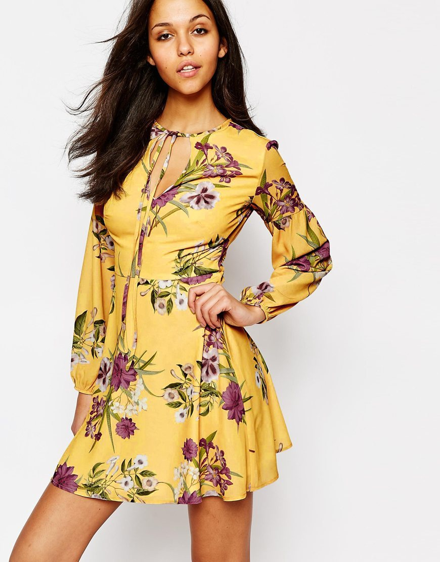 Long Sleeve Tea Dress With Keyhole And Tie Yellow Print - style: tea dress; length: mini; predominant colour: yellow; occasions: casual, creative work; fit: body skimming; neckline: peep hole neckline; fibres: polyester/polyamide - 100%; hip detail: subtle/flattering hip detail; sleeve length: long sleeve; sleeve style: standard; pattern type: fabric; pattern size: standard; pattern: florals; texture group: jersey - stretchy/drapey; season: a/w 2015; wardrobe: highlight