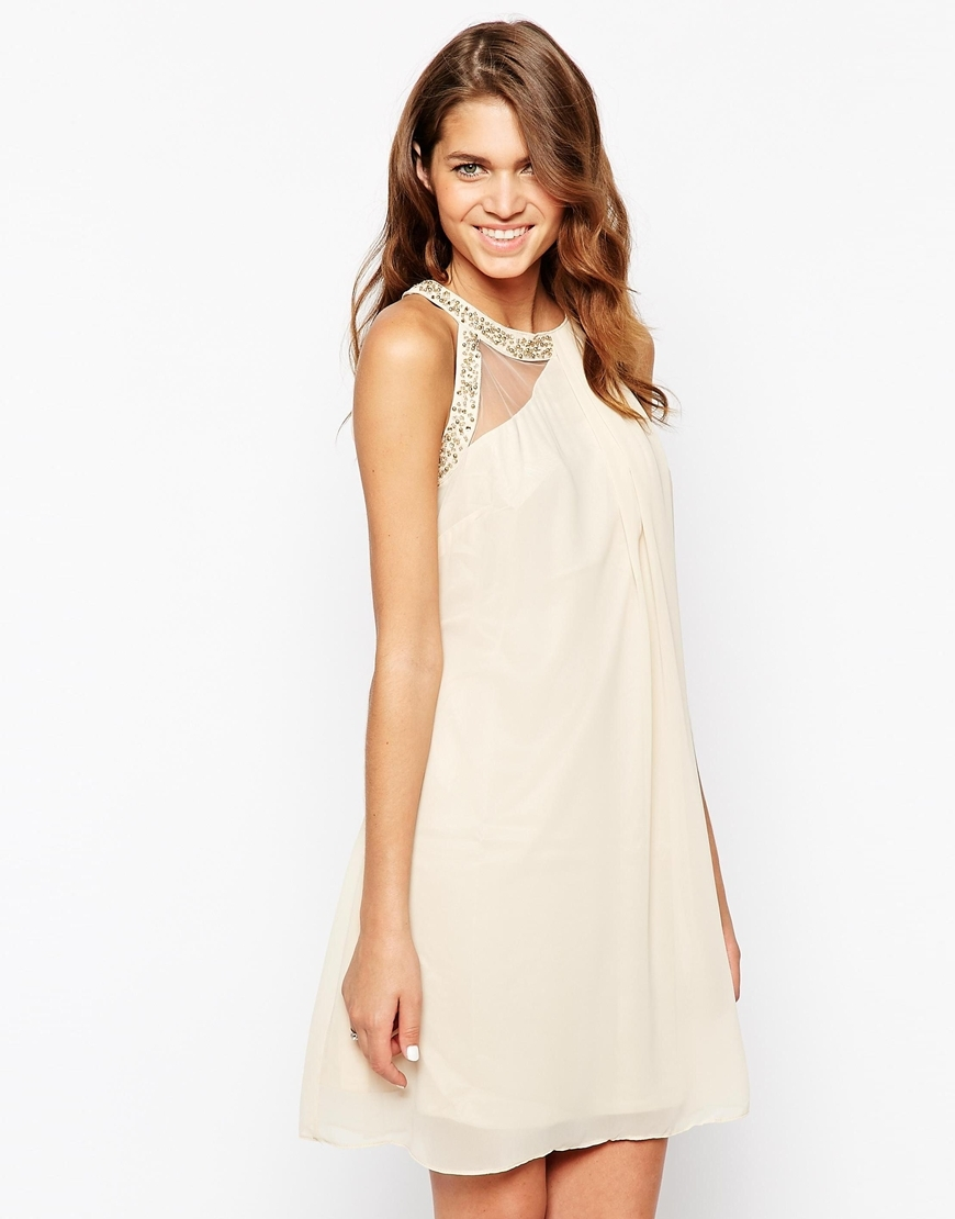 High Neck Prom Dress With Embellished Trim Nude - length: mid thigh; neckline: round neck; fit: loose; pattern: plain; sleeve style: sleeveless; style: asymmetric (top); predominant colour: nude; occasions: evening, occasion; fibres: polyester/polyamide - 100%; sleeve length: sleeveless; texture group: sheer fabrics/chiffon/organza etc.; pattern type: fabric; embellishment: sequins; season: a/w 2015; wardrobe: event; embellishment location: bust