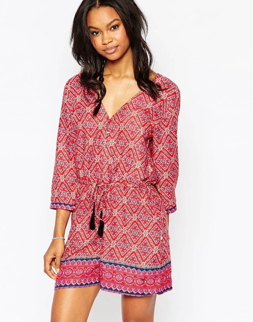 Bindi Playsuit Queen Of Diamonds - neckline: v-neck; fit: fitted at waist; pattern: plain; length: short shorts; predominant colour: pink; occasions: casual, holiday; fibres: cotton - mix; sleeve length: 3/4 length; sleeve style: standard; texture group: crepes; style: playsuit; pattern type: fabric; pattern size: light/subtle; season: a/w 2015; wardrobe: holiday