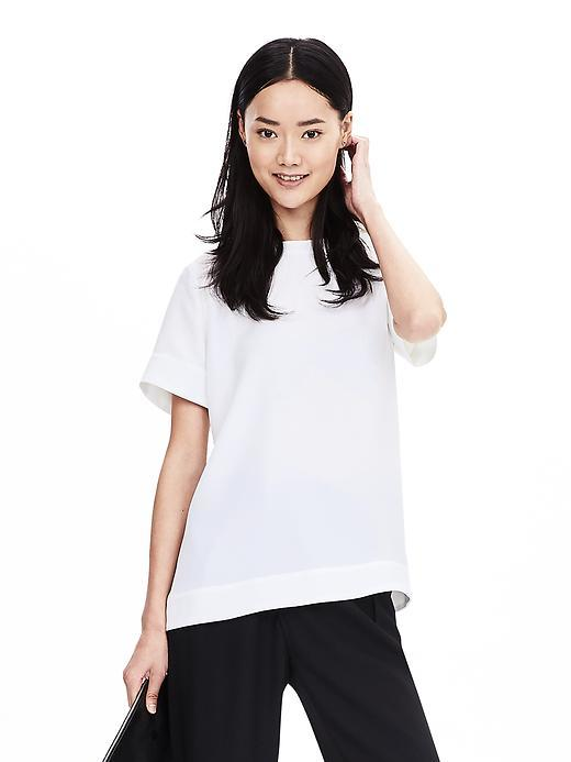 White Crepe Top White - pattern: plain; style: t-shirt; predominant colour: white; occasions: casual, creative work; length: standard; fibres: polyester/polyamide - 100%; fit: loose; neckline: crew; sleeve length: short sleeve; sleeve style: standard; texture group: crepes; pattern type: fabric; season: s/s 2016; wardrobe: basic