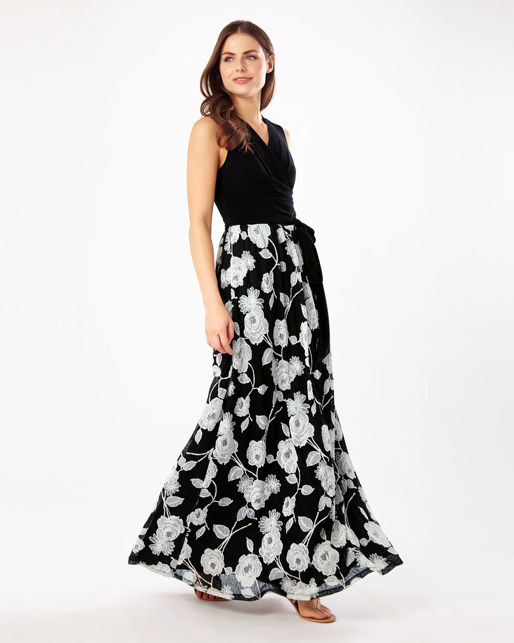 Gwenda Lace Dress - neckline: v-neck; sleeve style: sleeveless; style: maxi dress; length: ankle length; waist detail: belted waist/tie at waist/drawstring; secondary colour: white; predominant colour: black; occasions: evening; fit: fitted at waist & bust; fibres: polyester/polyamide - 100%; hip detail: soft pleats at hip/draping at hip/flared at hip; sleeve length: sleeveless; trends: monochrome; texture group: sheer fabrics/chiffon/organza etc.; pattern type: fabric; pattern size: standard; pattern: florals; season: s/s 2016