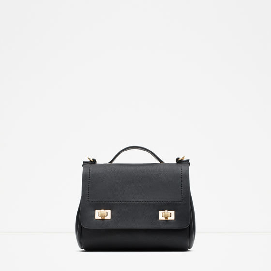 Mini Messenger Bag With Chain - predominant colour: black; occasions: casual, creative work; type of pattern: standard; style: messenger; length: across body/long; size: standard; material: faux leather; pattern: plain; finish: plain; embellishment: chain/metal; season: s/s 2016; wardrobe: highlight