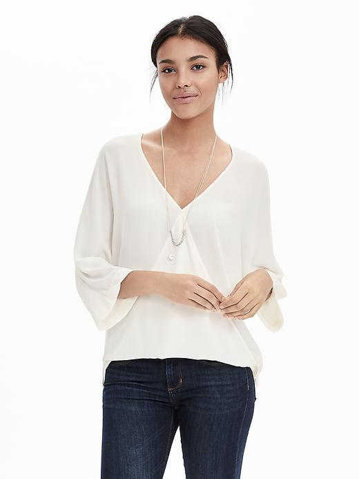 Dolman Faux Wrap Blouse Cocoon - neckline: low v-neck; sleeve style: bell sleeve; pattern: plain; style: blouse; predominant colour: ivory/cream; occasions: work, creative work; length: standard; fibres: polyester/polyamide - 100%; fit: loose; sleeve length: half sleeve; texture group: sheer fabrics/chiffon/organza etc.; pattern type: fabric; season: s/s 2016; wardrobe: basic