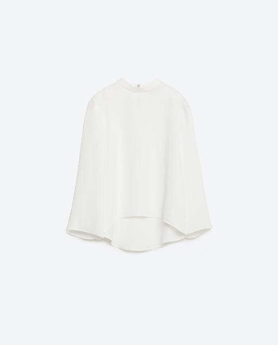 High Neck Top - pattern: plain; predominant colour: ivory/cream; occasions: evening, creative work; length: standard; style: top; neckline: collarstand; fibres: polyester/polyamide - 100%; fit: loose; sleeve style: cape sleeve; sleeve length: long sleeve; texture group: crepes; pattern type: fabric; season: s/s 2016
