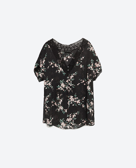 Printed Blouse - neckline: v-neck; length: below the bottom; style: t-shirt; secondary colour: blush; predominant colour: black; occasions: casual, creative work; fibres: polyester/polyamide - 100%; fit: body skimming; sleeve length: short sleeve; sleeve style: standard; pattern type: fabric; pattern size: light/subtle; pattern: florals; texture group: jersey - stretchy/drapey; season: s/s 2016; wardrobe: highlight; embellishment location: bust