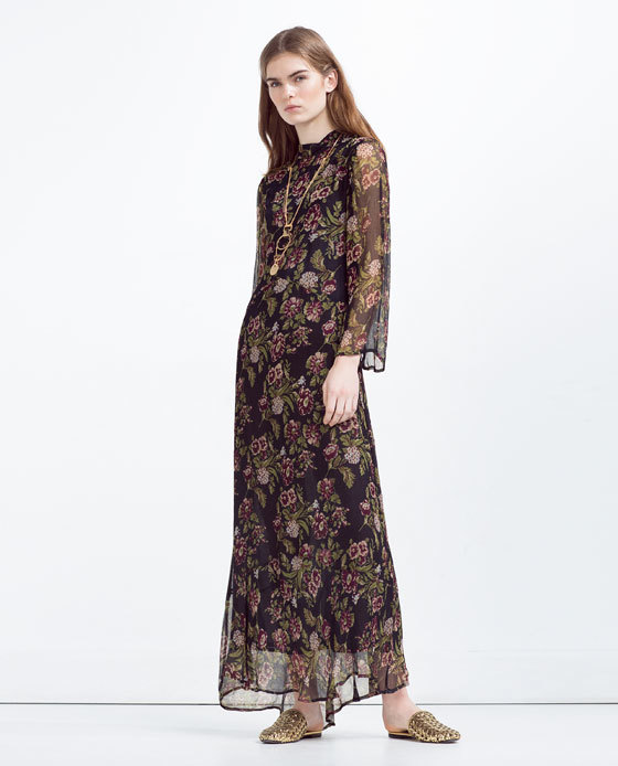 Long Dress With Floral Print - style: maxi dress; secondary colour: khaki; predominant colour: black; occasions: evening; length: floor length; fit: body skimming; neckline: collarstand; fibres: viscose/rayon - 100%; sleeve length: long sleeve; sleeve style: standard; texture group: sheer fabrics/chiffon/organza etc.; pattern type: fabric; pattern: florals; multicoloured: multicoloured; season: s/s 2016; wardrobe: event