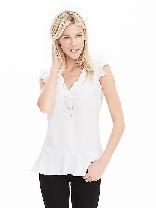 V Neck Ruffle Tank White - neckline: v-neck; sleeve style: angel/waterfall; pattern: plain; predominant colour: white; occasions: casual; length: standard; style: top; fibres: polyester/polyamide - 100%; fit: body skimming; sleeve length: short sleeve; texture group: crepes; hip detail: ruffles/tiers/tie detail at hip; pattern type: fabric; season: s/s 2016; wardrobe: highlight