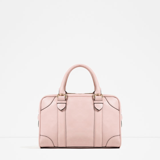 Buckled Bowling Bag - predominant colour: blush; occasions: casual, creative work; type of pattern: standard; style: bowling; length: handle; size: standard; material: faux leather; pattern: plain; finish: plain; embellishment: buckles; season: s/s 2016