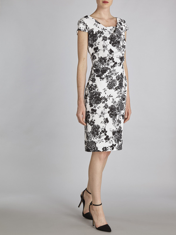 Gina Bacconi Black And White Floral Pique Knit Dress - style: shift; neckline: round neck; sleeve style: capped; fit: tailored/fitted; predominant colour: ivory/cream; secondary colour: charcoal; length: on the knee; fibres: polyester/polyamide - 100%; occasions: occasion; sleeve length: short sleeve; pattern type: fabric; pattern: florals; texture group: other - light to midweight; season: s/s 2016; wardrobe: event