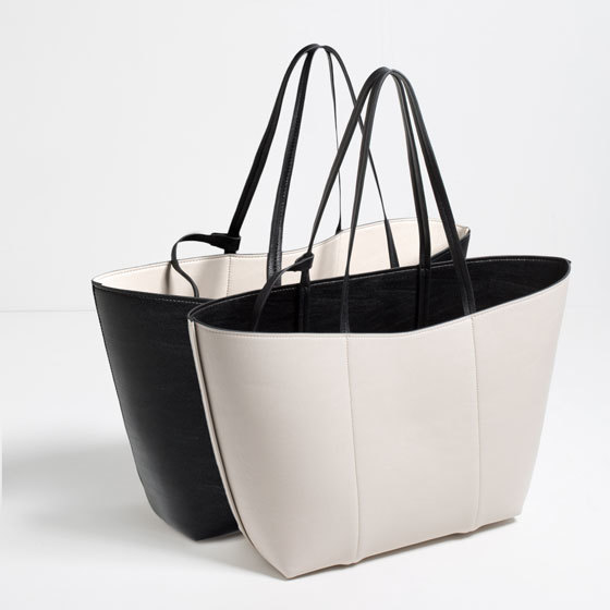 Reversible Tote - secondary colour: ivory/cream; predominant colour: black; occasions: casual, work, creative work; type of pattern: standard; style: tote; length: shoulder (tucks under arm); size: standard; material: faux leather; pattern: plain; finish: plain; season: s/s 2016; wardrobe: investment