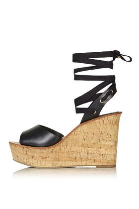 Wise Ankle Tie Wedge - predominant colour: black; occasions: casual, holiday; material: leather; ankle detail: ankle tie; heel: wedge; toe: open toe/peeptoe; style: strappy; finish: plain; pattern: plain; heel height: very high; shoe detail: platform; season: s/s 2016; wardrobe: investment