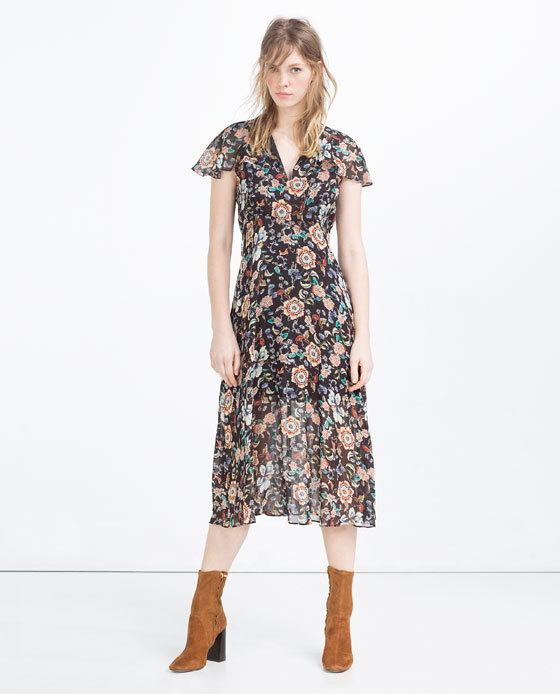 Printed Dress - style: tea dress; length: calf length; neckline: v-neck; sleeve style: capped; secondary colour: nude; predominant colour: black; occasions: casual, creative work; fit: fitted at waist & bust; fibres: polyester/polyamide - 100%; hip detail: subtle/flattering hip detail; sleeve length: short sleeve; texture group: sheer fabrics/chiffon/organza etc.; pattern type: fabric; pattern size: standard; pattern: florals; multicoloured: multicoloured; season: s/s 2016; wardrobe: highlight