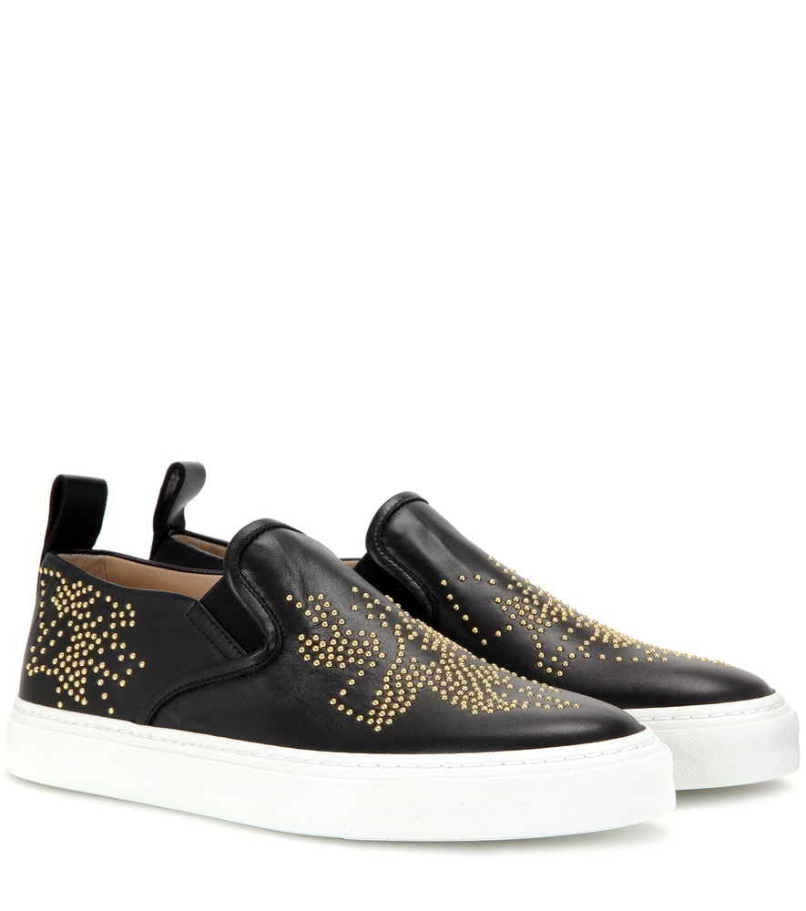 Susanna Embellished Leather Slip On Sneakers - secondary colour: gold; predominant colour: black; material: leather; heel height: flat; embellishment: studs; toe: round toe; style: trainers; finish: plain; pattern: patterned/print; occasions: creative work; shoe detail: moulded soul; season: s/s 2016; wardrobe: highlight