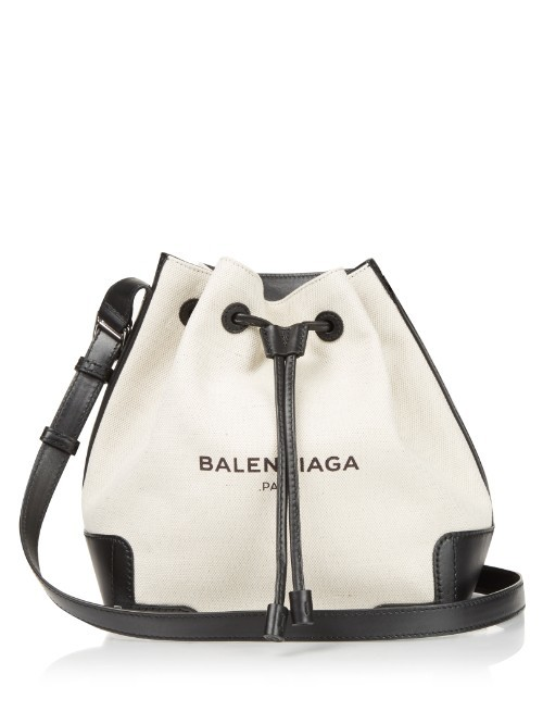 Canvas And Leather Bucket Bag - predominant colour: white; secondary colour: black; occasions: casual, creative work; type of pattern: light; style: onion bag; length: shoulder (tucks under arm); size: small; material: leather; embellishment: tassels; trends: monochrome; finish: plain; pattern: colourblock; season: s/s 2016; wardrobe: highlight