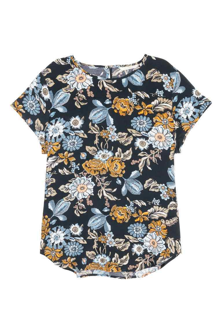Short Sleeved Blouse - style: blouse; secondary colour: denim; predominant colour: black; occasions: casual; length: standard; fibres: cotton - 100%; fit: body skimming; neckline: crew; sleeve length: short sleeve; sleeve style: standard; pattern type: fabric; pattern size: standard; pattern: florals; texture group: jersey - stretchy/drapey; multicoloured: multicoloured; season: s/s 2016; wardrobe: highlight