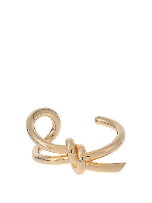 Asymmetric Bow Cuff - predominant colour: gold; style: cuff; size: standard; material: chain/metal; finish: metallic; occasions: creative work; season: s/s 2016