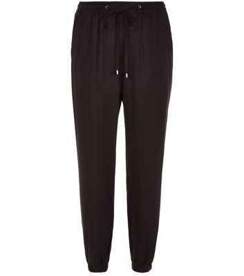 Black Viscose Joggers - pattern: plain; style: tracksuit pants; waist detail: belted waist/tie at waist/drawstring; waist: mid/regular rise; predominant colour: black; occasions: casual, creative work; length: ankle length; fibres: polyester/polyamide - 100%; texture group: crepes; fit: baggy; pattern type: fabric; season: s/s 2016; wardrobe: basic