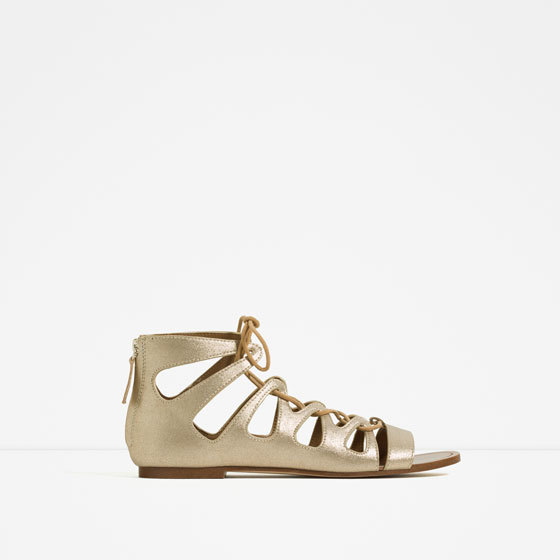 Flat Metallic Roman Sandals - predominant colour: gold; occasions: casual, holiday; material: faux leather; heel height: flat; ankle detail: ankle strap; heel: standard; toe: open toe/peeptoe; style: gladiators; finish: metallic; pattern: plain; season: s/s 2016; wardrobe: basic