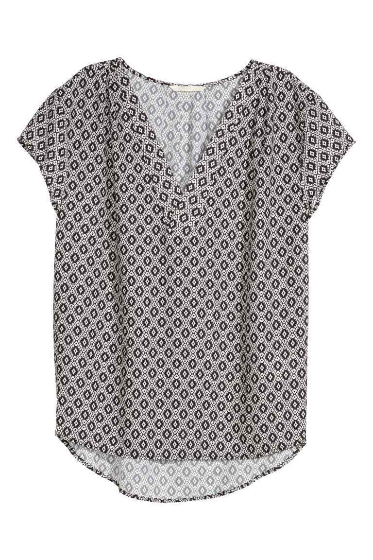 V Neck Blouse - neckline: low v-neck; length: below the bottom; style: blouse; secondary colour: light grey; predominant colour: black; occasions: casual; fibres: polyester/polyamide - 100%; fit: body skimming; sleeve length: short sleeve; sleeve style: standard; pattern type: fabric; pattern size: standard; pattern: patterned/print; texture group: other - light to midweight; season: s/s 2016
