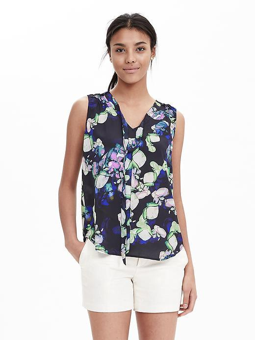 Floral Sleeveless Tie Blouse Preppy Navy - neckline: v-neck; sleeve style: sleeveless; style: blouse; secondary colour: ivory/cream; predominant colour: navy; occasions: casual; length: standard; fibres: polyester/polyamide - 100%; fit: body skimming; sleeve length: sleeveless; texture group: sheer fabrics/chiffon/organza etc.; pattern type: fabric; pattern: florals; multicoloured: multicoloured; season: s/s 2016