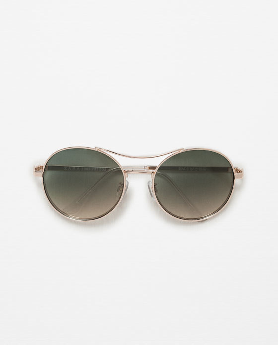 Round Sunglasses - predominant colour: gold; occasions: casual, holiday, creative work; style: round; size: standard; material: chain/metal; pattern: plain; finish: metallic; season: s/s 2016; wardrobe: basic