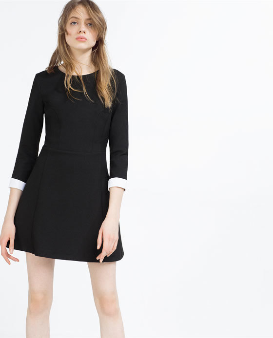 Short Dress With White Cuffs - style: shift; length: mid thigh; fit: tailored/fitted; pattern: plain; secondary colour: white; predominant colour: black; occasions: evening; fibres: polyester/polyamide - stretch; neckline: crew; sleeve length: 3/4 length; sleeve style: standard; pattern type: fabric; texture group: jersey - stretchy/drapey; season: s/s 2016; wardrobe: event