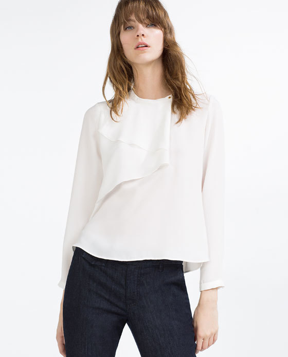 Blouse With Frill And Snap Closure - pattern: plain; style: blouse; bust detail: subtle bust detail; predominant colour: white; occasions: casual; length: standard; fibres: polyester/polyamide - 100%; fit: body skimming; neckline: crew; sleeve length: long sleeve; sleeve style: standard; pattern type: fabric; texture group: other - light to midweight; season: s/s 2016; wardrobe: basic