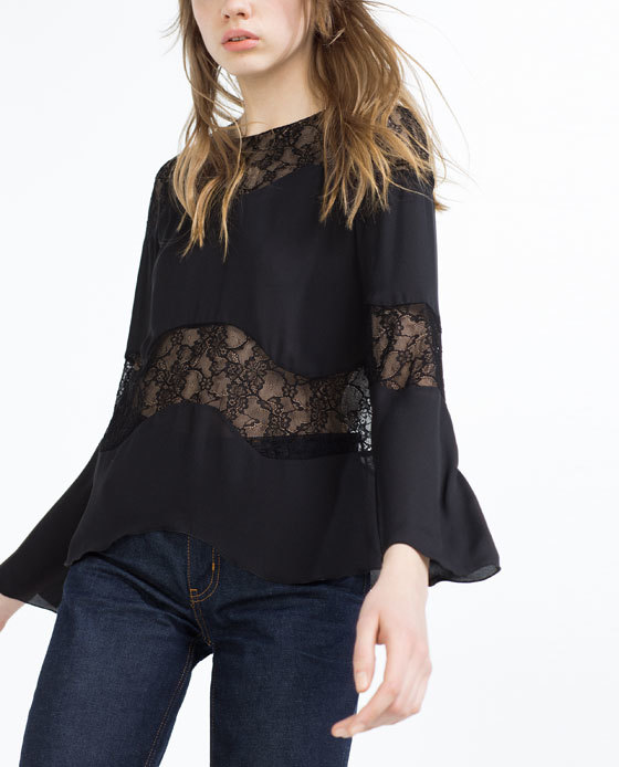 Lace Top - bust detail: sheer at bust; predominant colour: black; occasions: evening; length: standard; style: top; fibres: polyester/polyamide - 100%; fit: body skimming; neckline: crew; sleeve length: long sleeve; sleeve style: standard; texture group: lace; pattern type: fabric; pattern: patterned/print; embellishment: lace; season: s/s 2016; wardrobe: event