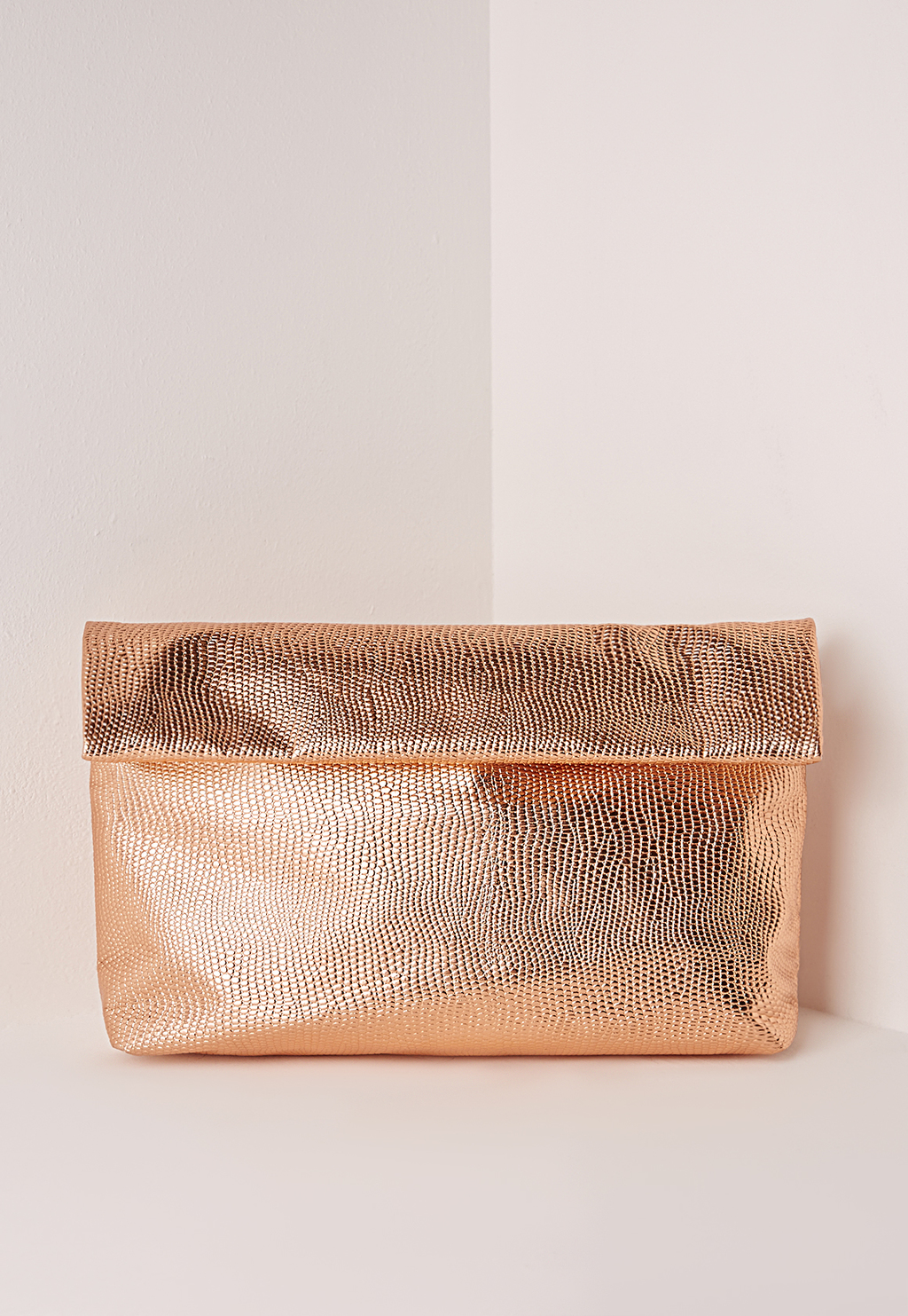 Roll Top Clutch Rose Gold, Red - predominant colour: gold; occasions: evening; type of pattern: standard; style: clutch; length: hand carry; size: standard; material: faux leather; pattern: plain; finish: metallic; season: s/s 2016; wardrobe: event