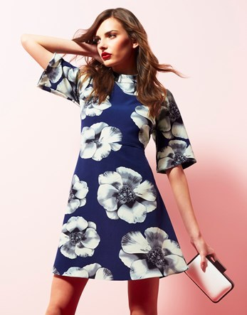 Floral A Line Dress - style: a-line; length: mid thigh; sleeve style: dolman/batwing; neckline: high neck; predominant colour: navy; secondary colour: light grey; occasions: evening, occasion; fit: soft a-line; fibres: polyester/polyamide - 100%; sleeve length: half sleeve; pattern type: fabric; pattern size: standard; pattern: florals; texture group: woven light midweight; season: s/s 2016; wardrobe: event