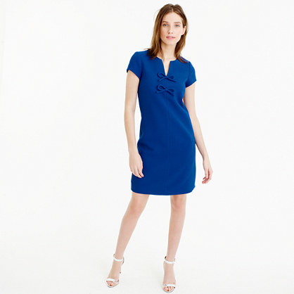 Petite Presentation Dress - style: shift; neckline: v-neck; sleeve style: capped; pattern: plain; predominant colour: royal blue; occasions: evening; length: on the knee; fit: body skimming; fibres: polyester/polyamide - stretch; sleeve length: short sleeve; pattern type: fabric; pattern size: standard; texture group: woven light midweight; embellishment: bow; season: s/s 2016; wardrobe: event; embellishment location: bust